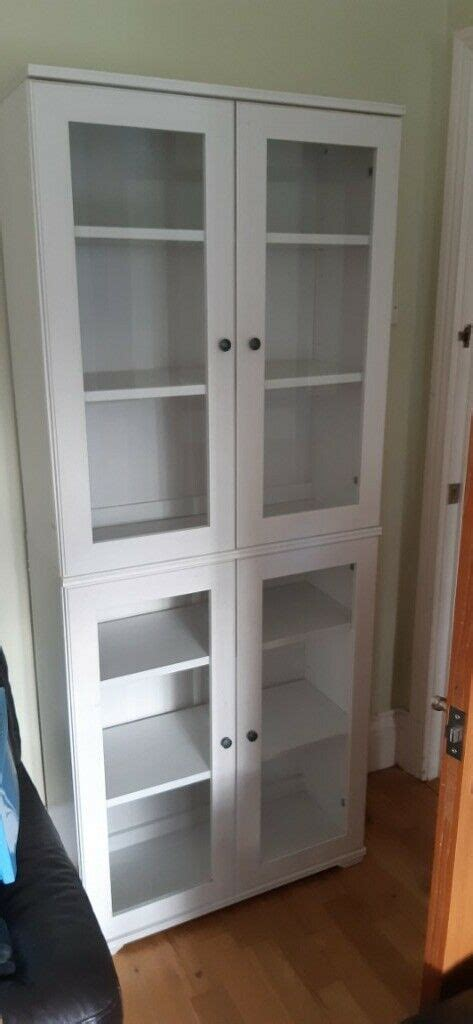 White tall bookcase /display cabinet from ikea with glass